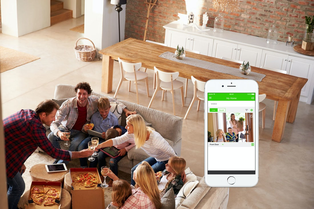 living-room-of-family-with-phone-image-of-cctv-camera