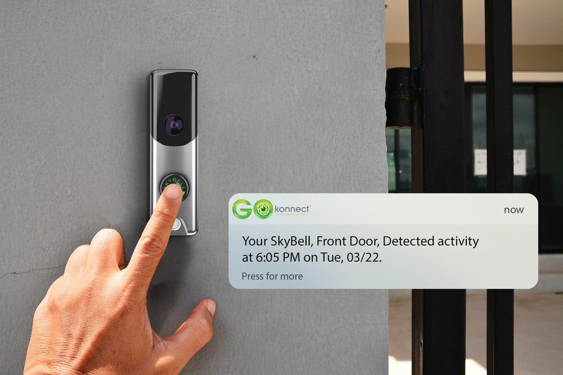 video_doorbell_on_front_wall_with_hand_pressing_button