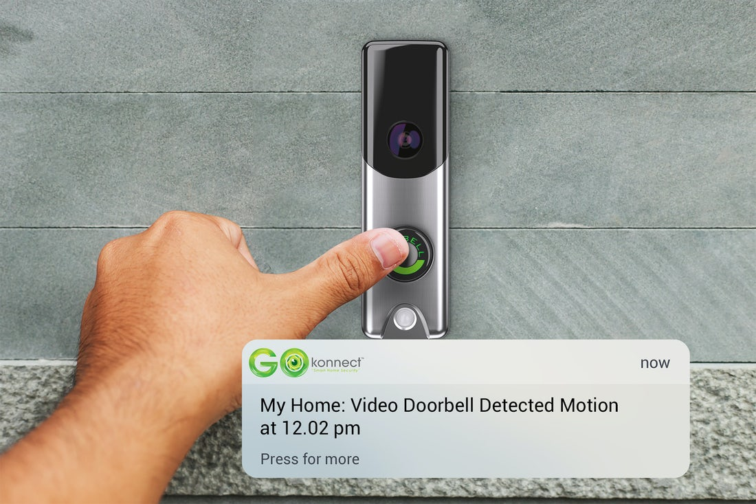 mounted-video-doorbell-camera-with-hand-hovering-over-button