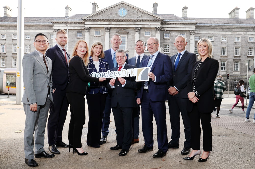Partners from accountancy firms Crowleys DFK & Anne Brady McQuillans DFK pictured announcing both firms are to merge.