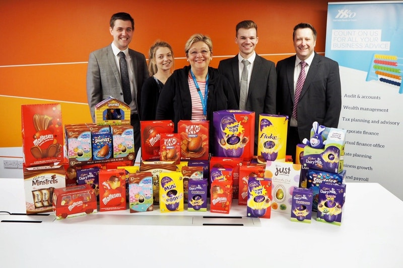 Harrison Beale & Owen donates over one hundred Easter Eggs to UHCW charity