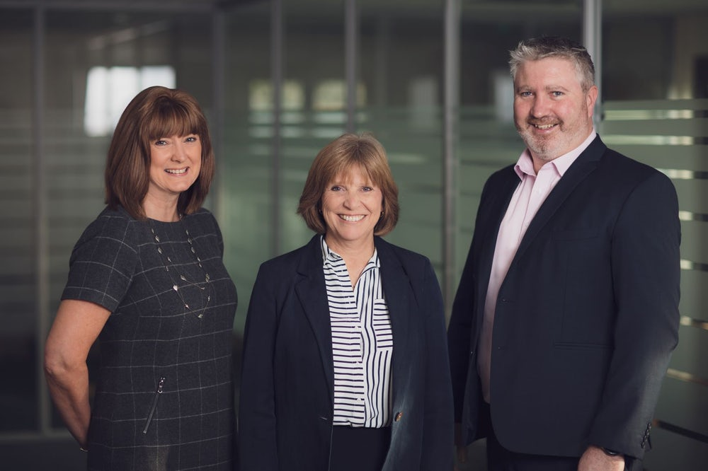 Pearson Buchholz directors Lynne Buchholz and Samantha Daniels pictured with Peter O'Connell, Manging Director at Shaw Gibbs Limited