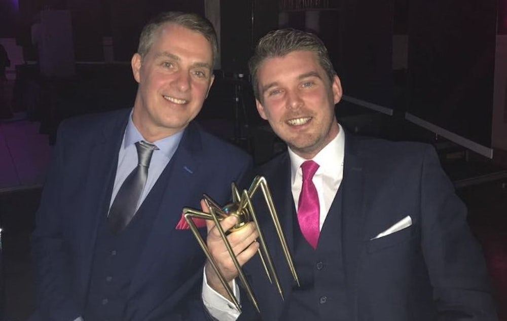 Ronan Morris with another team member and the gold spider