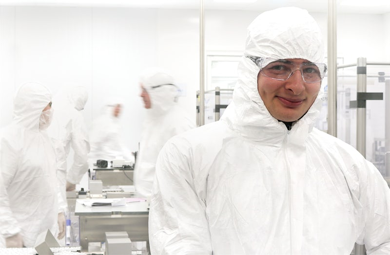 Production Specialist at work in manufacturing fill room at Technopath Clinical Diagnostics