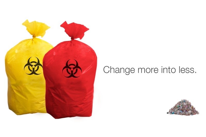 Red and yellow bags representing regulated medical waste sit beside equivalent shredded, treated waste.